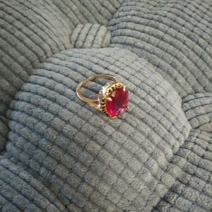Golden ring with red stone